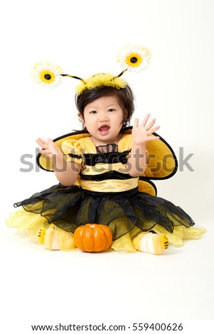 Baby girl dressed as cute little bee with a small pumpkin smiling  sc 1 st  Shutterstock & Baby Girl Dressed Cute Little Bee Stock Photo 559400626 - Shutterstock