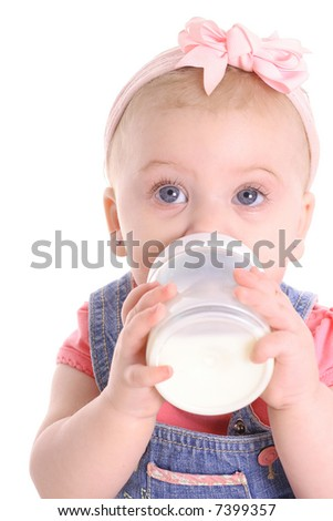 baby girl drinking a bottle - stock photo