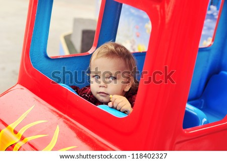 baby girl driving a train  in theme park