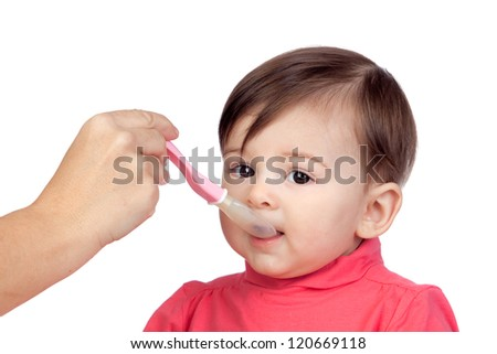 Baby girl eating isolated on white background - stock photo