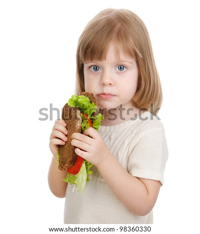 baby girl eating sandwich. isolated on white background - stock photo