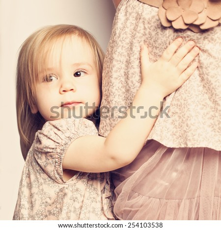 Baby girl embrace mom - love - stock photo