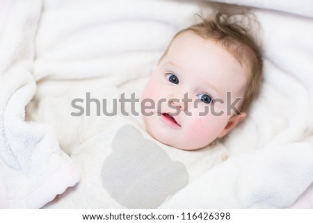 Baby girl in a knitted sweater and a warm blanket - stock photo