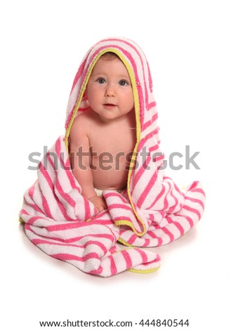 Baby girl in a pink and white towel cutout