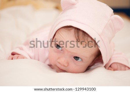Baby girl in a pink dress / Nice baby girl in a pink dress lying - stock photo