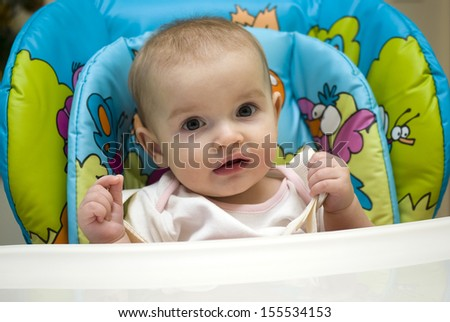 Baby girl in highchair