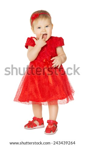 Baby Girl in Red Dress. Happy Child in Holiday Clothes Suck Finger. Isolated White Background