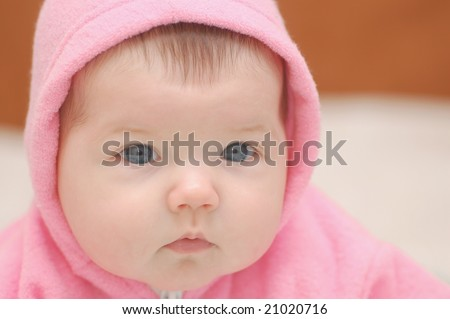 Baby girl in rose hood
