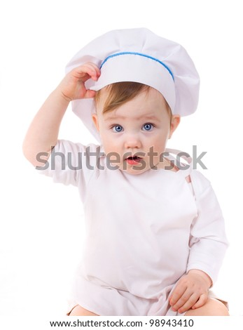 Baby girl in the cook hat isolated on white background - stock photo