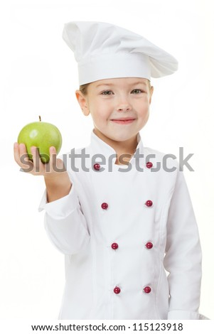Baby girl in the cook hat with green apple - stock photo