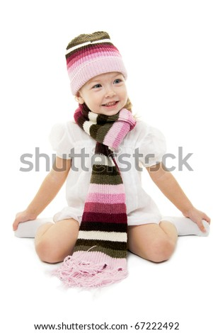 Baby girl in winter wool hat and scarf