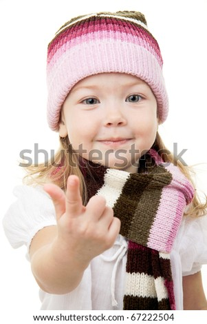 Baby girl in winter wool hat and scarf - stock photo