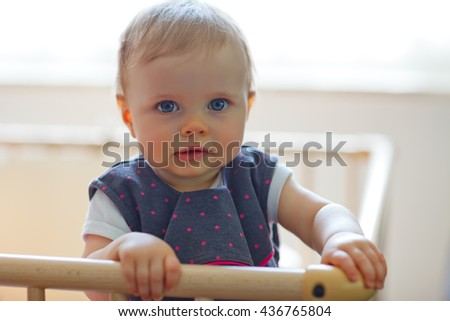 baby girl inside a playpen