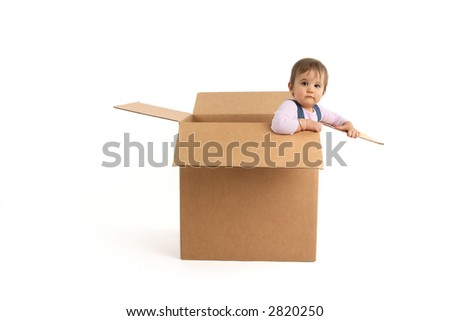baby girl inside box, trying to get out - stock photo