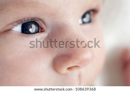 baby girl is having eyes open - stock photo