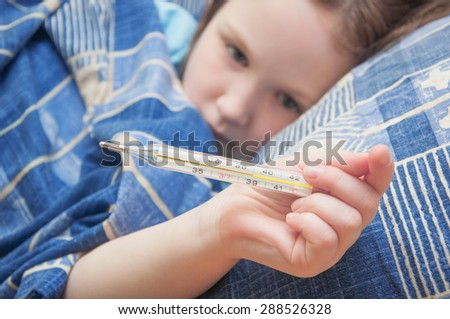 baby girl is sick with influenza. body temperature measurement - stock photo
