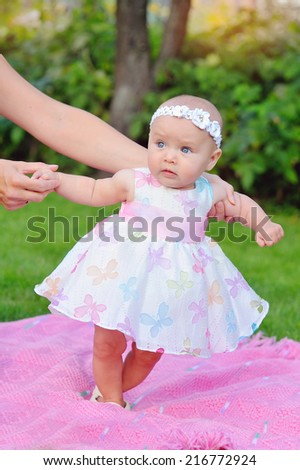baby girl outdoors in a dress - stock photo