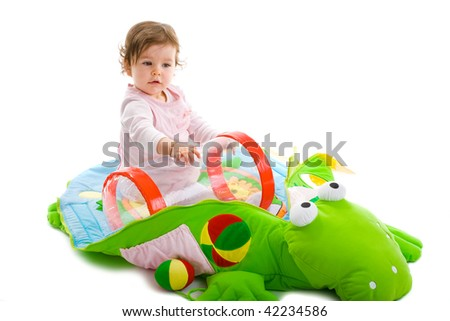 Baby girl playing in baby gym, isolated on white background. - stock photo