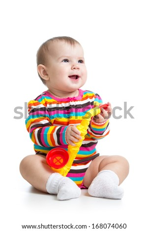 baby girl playing musical toy isolated on white - stock photo
