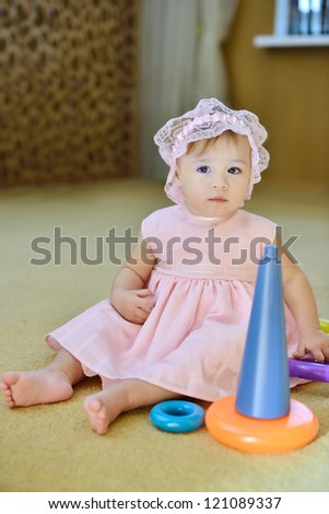 baby girl playing   toys at home