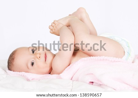 Baby girl playing with her feet