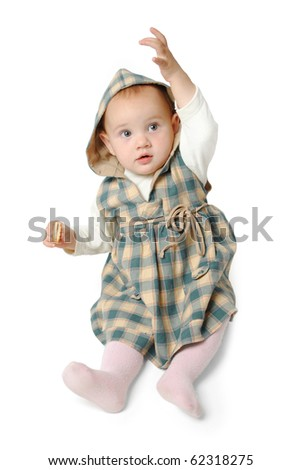 Baby girl pointing up isolated on white
