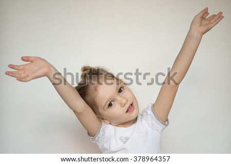 baby girl posing in the studio on a white background