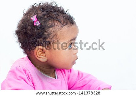 Baby girl's profile portrait on a white background