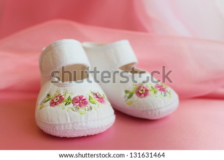 Baby girl's shoes - stock photo