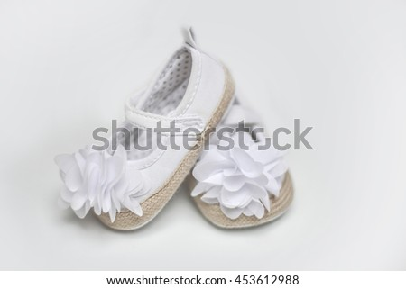 Baby girl shoes. - stock photo