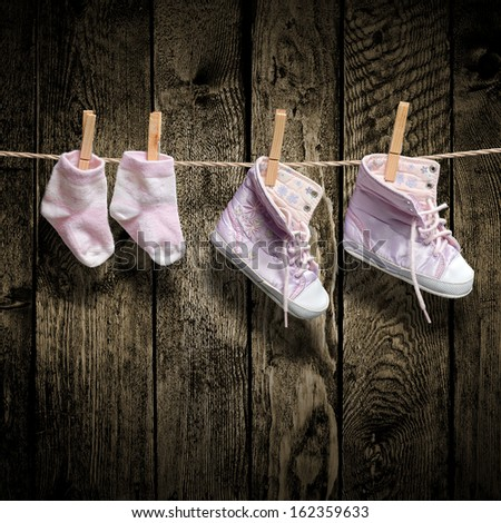 Baby girl shoes and socks on the clothesline