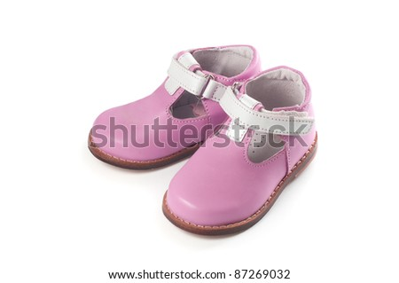 Baby girl shoes isolated on white - stock photo