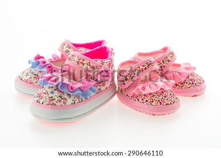 Baby girl shoes isolated on white background - stock photo