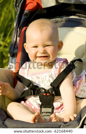 baby girl sitting in a pram