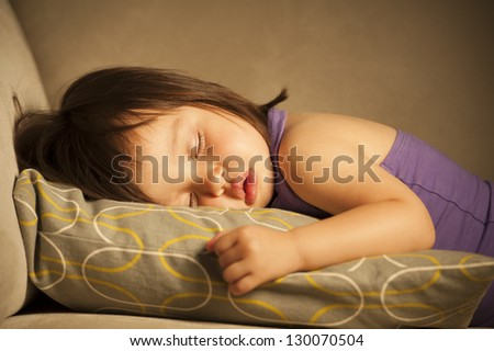 Baby girl taking a nap - stock photo
