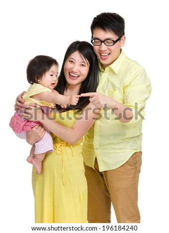 Baby girl touch finger with father - stock photo