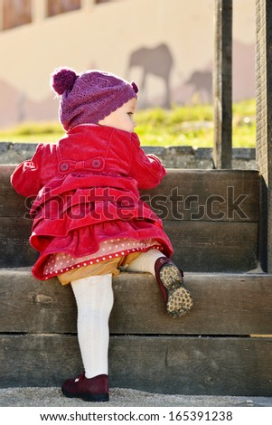 baby girl trying to walk staircase