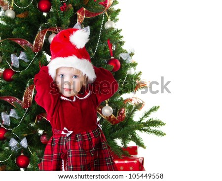 Baby girl under the Christmas tree isolated on white - stock photo