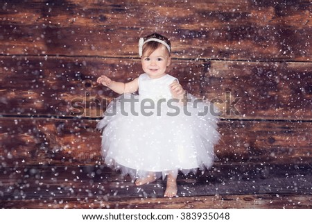 baby girl wearing a white dress - stock photo