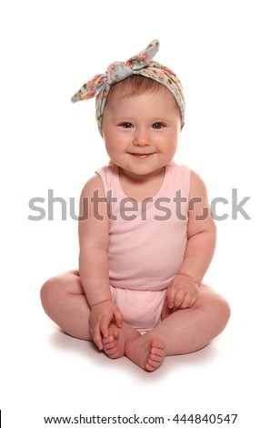 Baby girl wearing vintage floral headband cutout