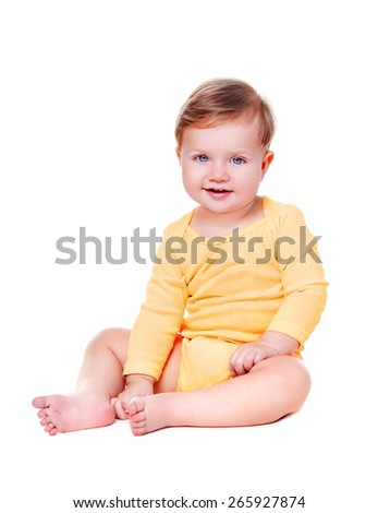 baby girl wearing yellow bodysuit - stock photo