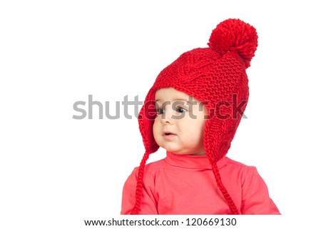 Baby girl with a funny wool red hat isolated on white background - stock photo