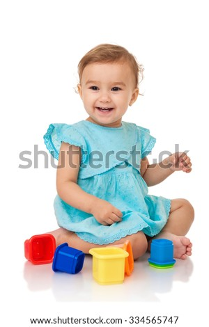 Baby girl with blocks, isolated on white