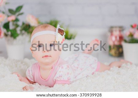 Baby girl with bow and flowers
