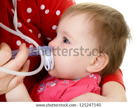 baby girl with cold and nasal aspirator on mother's hand - stock photo