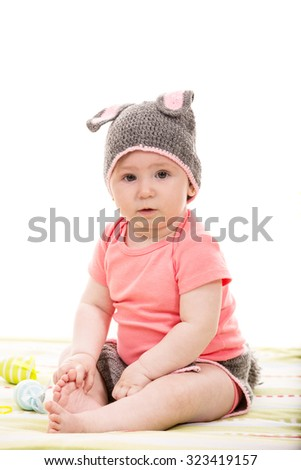 Baby girl with croched bunny hat  and Easter eggs