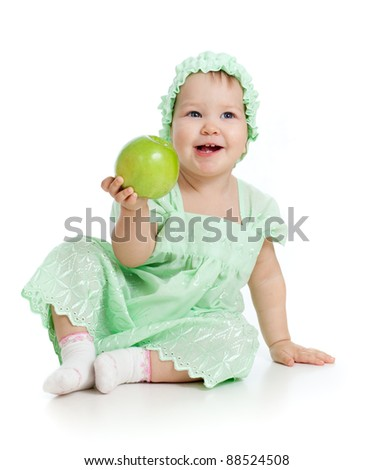 baby girl with green apple - stock photo
