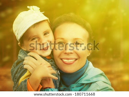 Baby girl with her mom on a nature outside. - stock photo