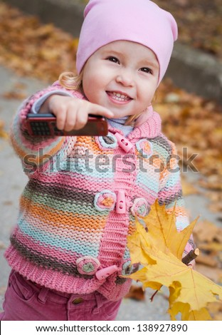 baby girl with mobile phone