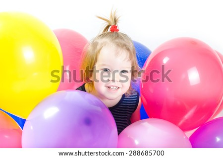 Baby girl with party balloons over white